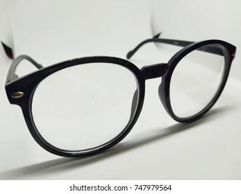 Glasses on the white floor.