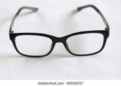 glasses on white paper.