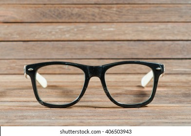 Glasses on wooden texture.