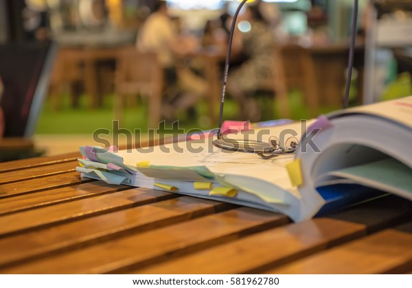 Glasses with an open book in a cafe.