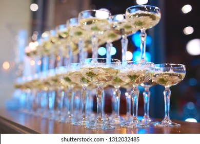 glasses originally arranged in two rows with a cocktail poured into them