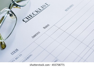 glasses over checklist form
