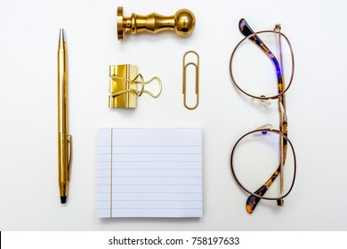 Glasses Pen Paper Clip Sticky Note Wax Stamp Seal White and Gold Minimal White Desk From Above