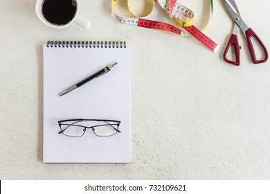 glasses and pencil place on note or sketch paper. work space of designer