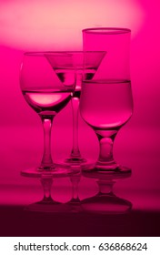 glasses in pink red glamour lighting