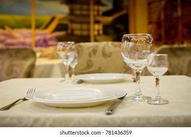 Glasses and plates on the serving table