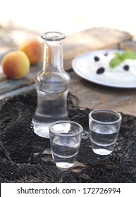 glasses of raki on a traditional cretan scarf