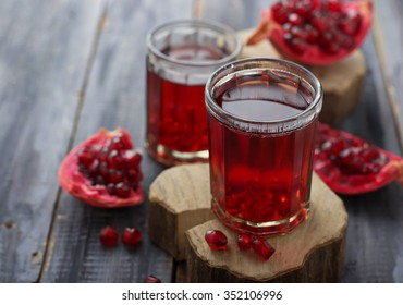 Glasses of red pomegranate juice. Selective focus