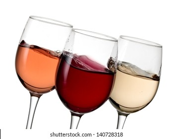 Glasses with red, white and rose wine plash, close up