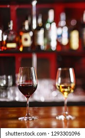 glasses of red and white wine in the bar
