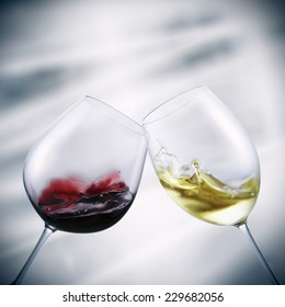 glasses of red and white wine toasting