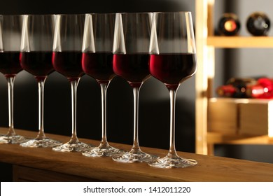 Glasses of red wine in cellar. Expensive drink