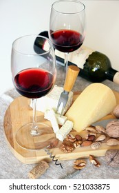 Glasses of red wine and cheese.