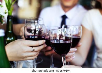 Glasses of red wine. The concept of party and celebration