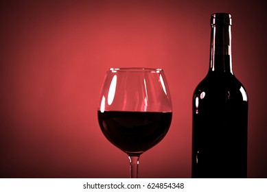 Glasses of red wine with food on vintage table closeup. place for typography