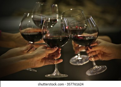 Glasses of red wine on a cheerful holiday
