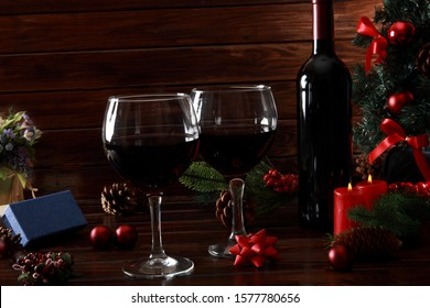 Glasses of Red Wine surrounded by Christmas Decoration