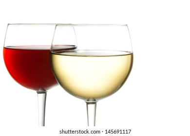 glasses of red wine and white wine against white background