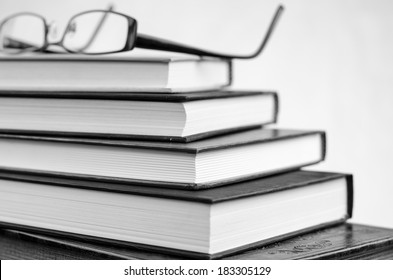 Glasses resting on open book