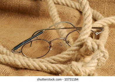 Glasses with rope and canvas sack
