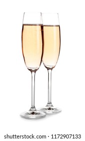Glasses of rose champagne on white background. Festive drink