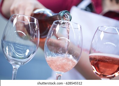 Glasses of rose wine from a bottle