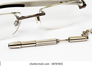 glasses and sentinel screwdriver on white background. Studio shot, not isolated