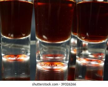 Glasses of shots on black background