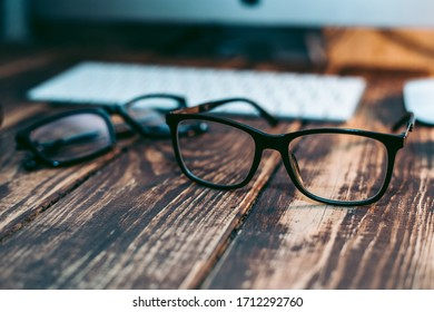 Glasses for sight and vision correction and protection from computer on the wooden table