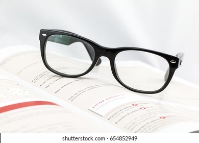 Glasses sitting on text book