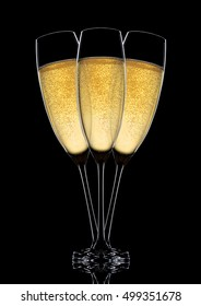 Glasses of sparkling champagne with bubbles  on black background