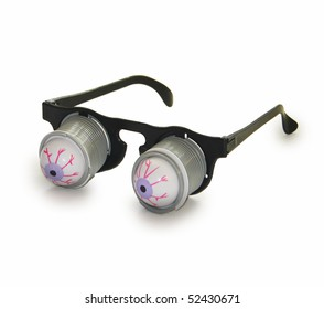 Glasses with a surprise in the form of pull-down eye. Isolated on white