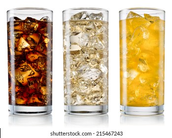Glasses of sweet carbonated drinks with ice cubes isolated on white. With clipping path