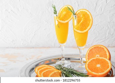 Glasses of tasty mimosa cocktails on table