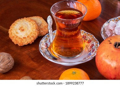 Glasses of tea and the Turkish delight on a table with fruits nuts and cookies