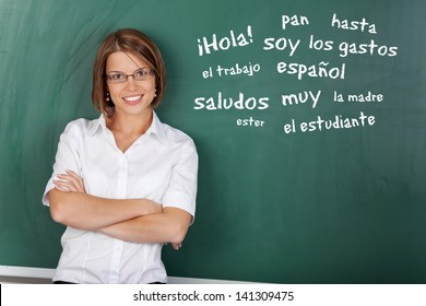 an with glasses teaching Spanish subject at the classroom