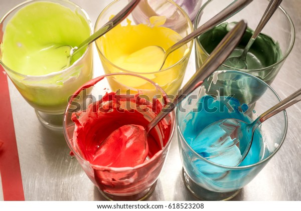 Glasses of various food coloring