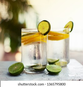 glasses of water with lemon  and lime in hot summer day