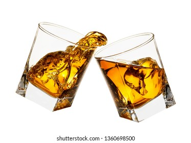 glasses of whiskey making toast with splashes isolated on white background