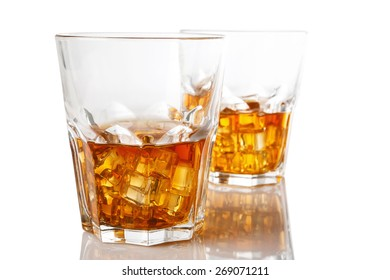Glasses with whiskey on white background