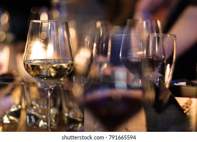 Glasses with white and red wine from thin glass on a table in a restaurant