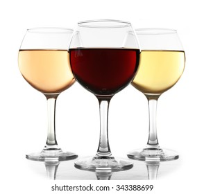 Glasses with white, rose and red wine isolated on white background