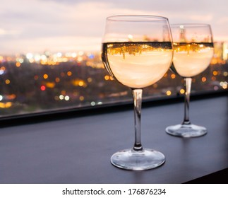 Glasses of white wine with city view