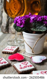 Glasses of white wine and cookies for Valentine's Day