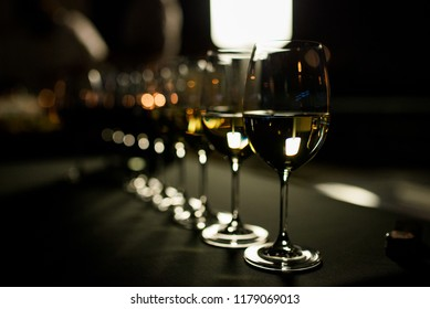 glasses of white wine at the evening reception at the party buffet