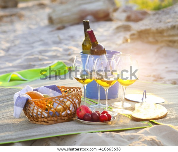 Glasses of the white wine on the beach summer picnic