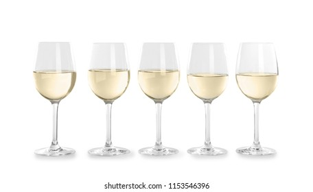 Glasses with white wine on light background