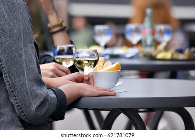 Glasses of white wine on outdoors table