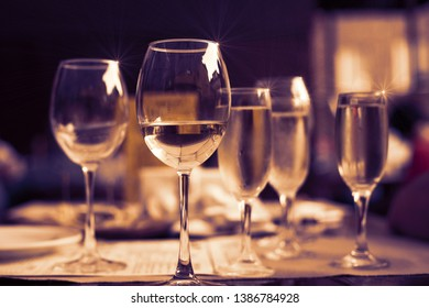 Glasses of  white wine on the table in the restaurant