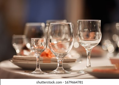 Glasses for wine and champagne on a served table at a banquet